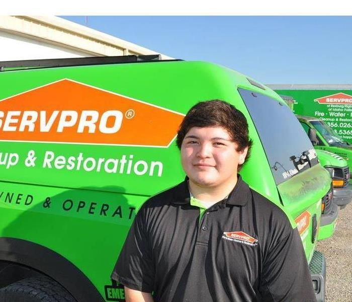 One of our crew chiefs Carlos standing in front of a SERVPRO truck