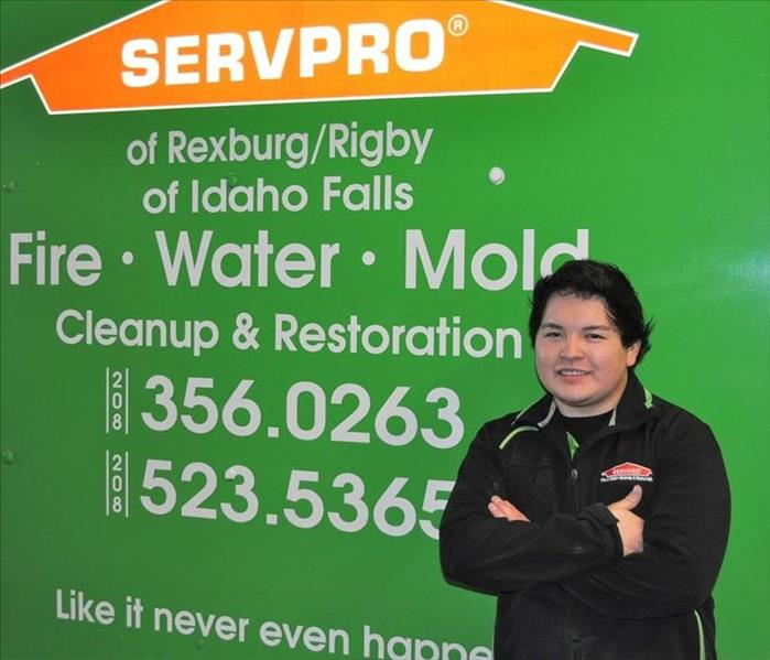 One of our crew chiefs  standing in front of a SERVPRO truck