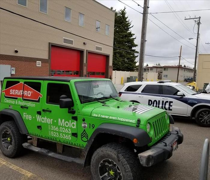 SERVPRO jeep parked next to a Police Vehicle