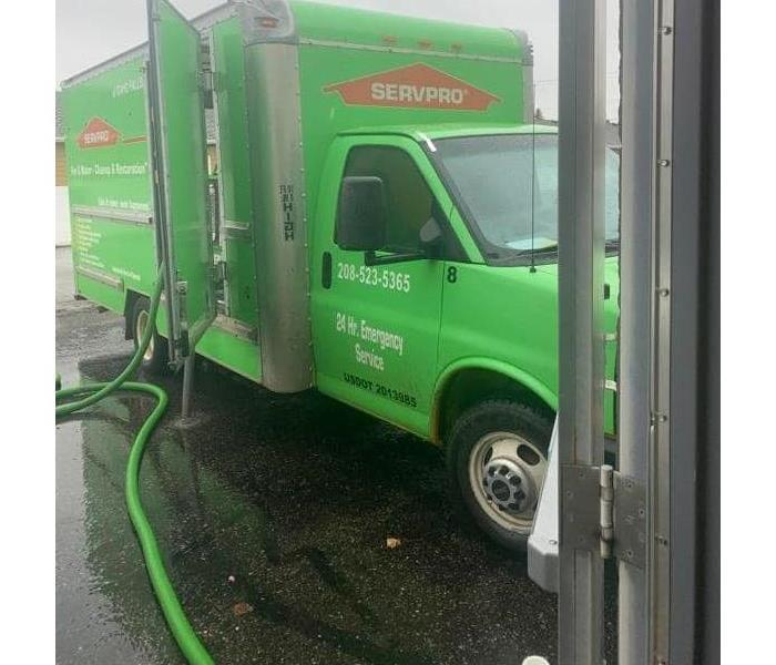 SERVPRO vehicle parked out in front of residential business