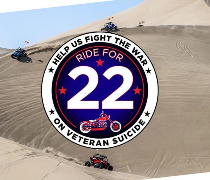 Four wheelers in sand dunes in background. Circle logo for Ride for 22